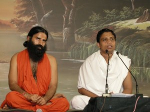 Baba Ramdev, left, in orange