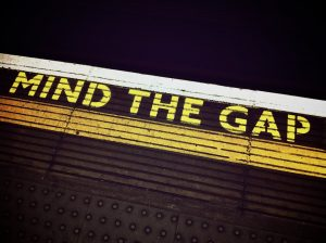 "Text reading ""mind the gap"" from a train station platform"