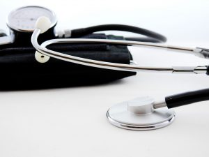 a stethoscope and sphygmomanometer on a white surface
