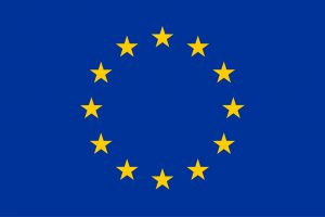 The EU flag, blue with 12 gold stars in a circle in the centre